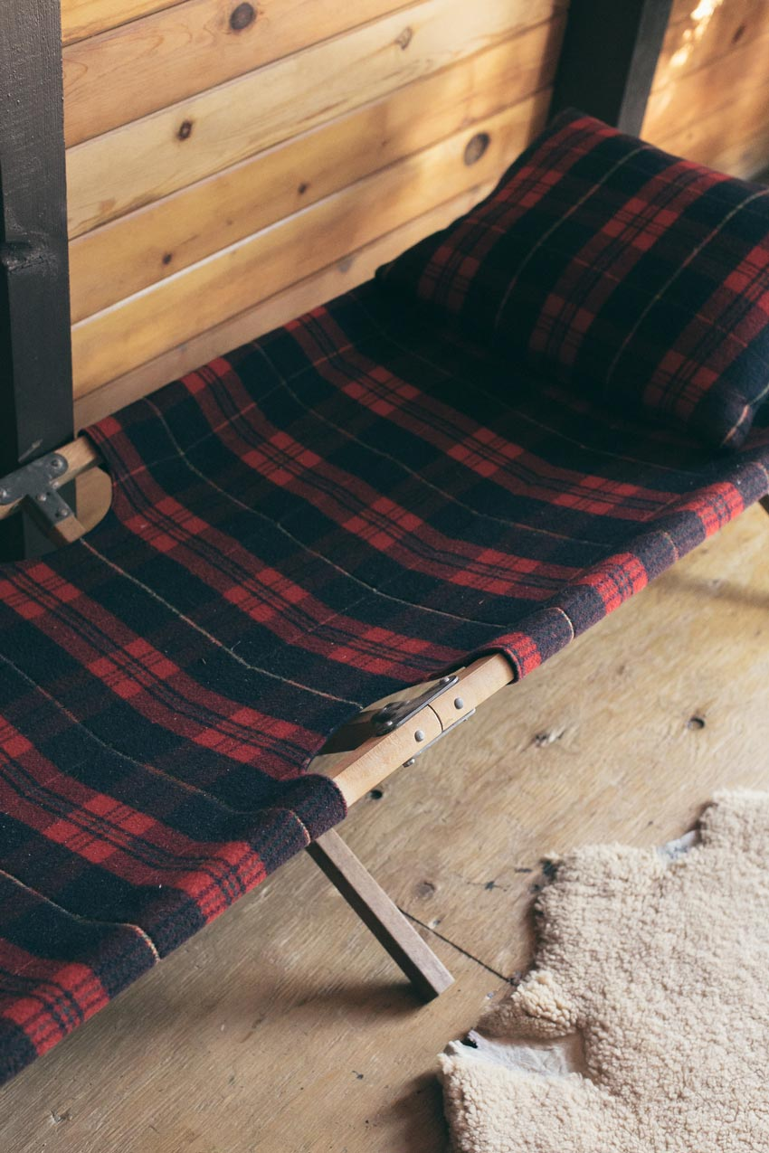 A Plaid Patterned Cot Sleeps Extra Guests In The Living Room In This Cabin Tour On Design*Sponge