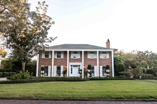 Reviving A 1965 Traditional Brick Georgian with A History of Hospitality